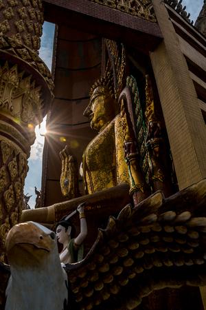 Golden Buddha cut beautiful light. (Silhouette)
