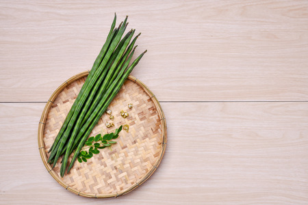 Moringa (Vegetable)  on the basket is the background.