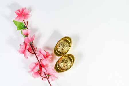 Chinese New Year decoration of cherry blossoms and yuan bao Stock Photo