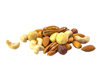 Assorted mixed nuts isolated on white background photo