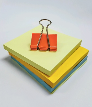 isolated: Paper clip and notepad