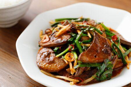 Stir-liver and garlic chives Stockfoto