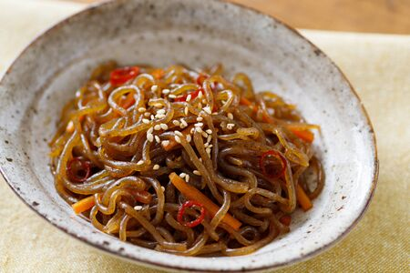 Konjac noodle and carrot cooked in sugar and soy sauce Stock Photo