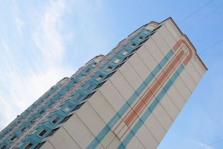 towerblock: new height dwelling-house on a background sky. diagonal foreshortening. Stock Photo