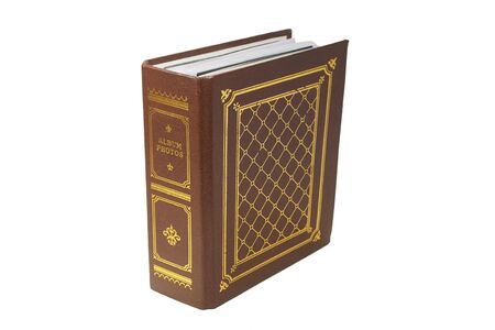 The brown photo album with  gold lettering on white background. Close-up. photo