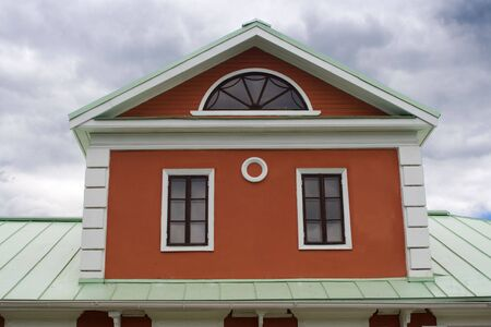 Garret of historical house with three windows on green metal roof. Tsaritsyno, Moscow. Stock Photo - 3358533