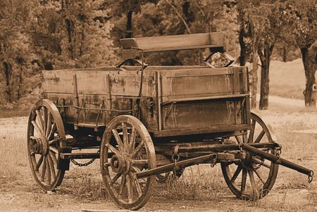 covered wagon: An old covered wagon in sepia Stock Photo