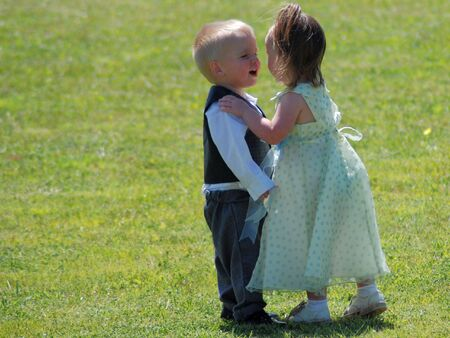 A young boy laughing at a young girl as she is trying to kiss him Stock Photo - 3051886