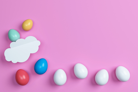 colorful easter eggs and cloud on pink background.Space for text. Minimal concept.Idea.Flat lay.Top view.