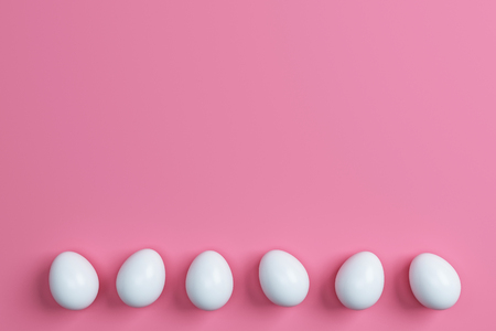 colorful easter eggs  on pink background.Space for text. Minimal concept.Idea.Flat lay.Top view.