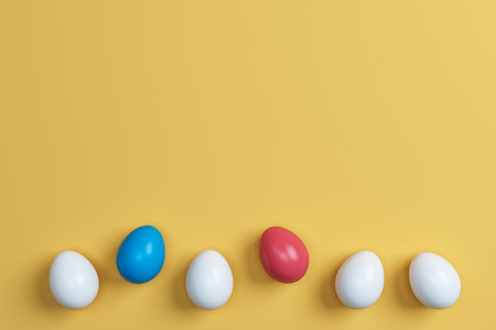 colorful easter eggs  on yellow background.Space for text. Minimal concept.Idea.Flat lay.Top view.