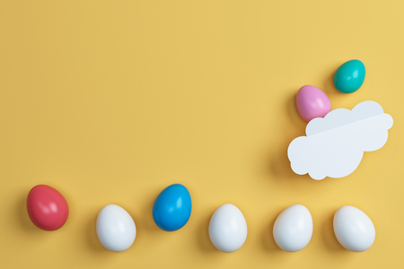 colorful easter eggs and on yellow background.Space for text. Minimal concept.Idea.Flat lay.Top view.