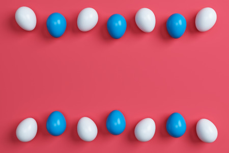 colorful easter eggs on red background.Space for text. Minimal concept.Idea.Flat lay.Top view.