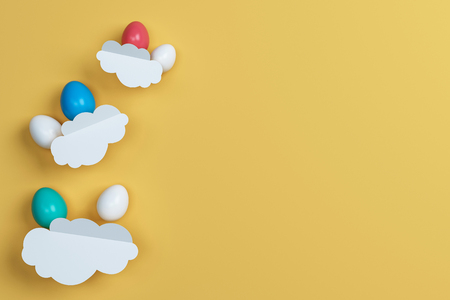 colorful Easter eggs and cloud on yellow  background. Space for text. Minimal concept. Abstract idea. Flat lay. Top view. 3d rendering. Stock Photo
