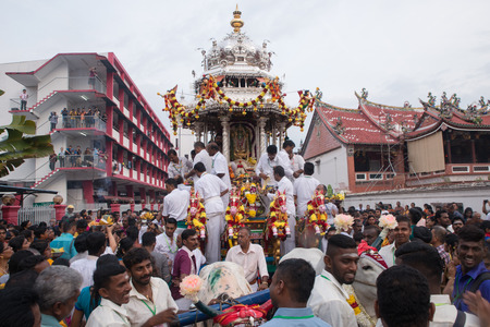 GEORGETOWN, PENANG/MALAYSIA ?€? CIRCA FEB 2017: Silver chariot with the devotees with background chinese temple and Beach Street Bomba station during Thaipusam.