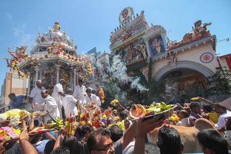 Georgetown,Penang.Malaysia – CIRCA JAN 2016: Devotees make their offering for lord Murugan in silver chariot in front Sri Kamatchi Amman Temple.