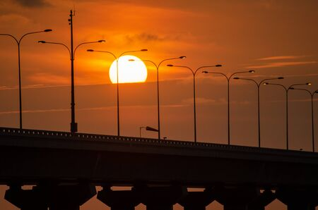 Sun start disappear in the cloud at Penang second bridge. 版權商用圖片