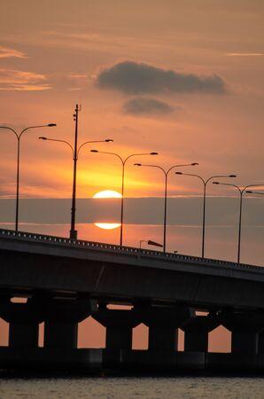 Half of sun disappear in cloud at Penang second bridge. 版權商用圖片