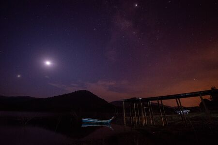 Moon rise and star at night at Tasik Pedu, Kedah, Malaysia. Stock Photo