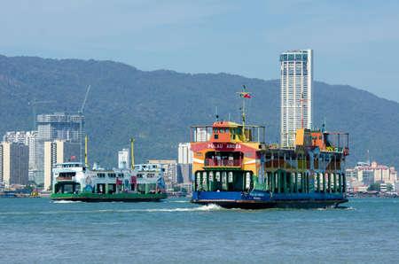 Butterworth, Penang/Malaysia - Jan 01 2020: Two ferry move at Penang sea.