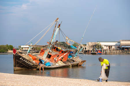 Sekinchan, Selangor/Malaysia - Oct 06 2019: A Malays fishing at the coastal.