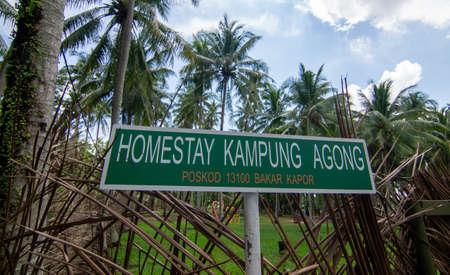 Penaga, PenangMalaysia - Oct 27 2019: Signboard homestay Kampung Agong.