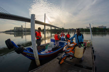 Butterworth, Penang/Malaysia - Jul 01 2018: Anglers gather jetty to go for fishing.
