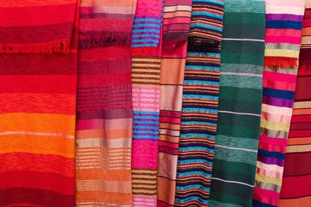 bedcover: Variety of colorful stripy bedcovers on market in Morocco