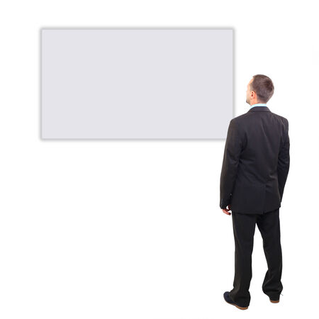 Full length of a handsome business man with hands folded against white background  photo