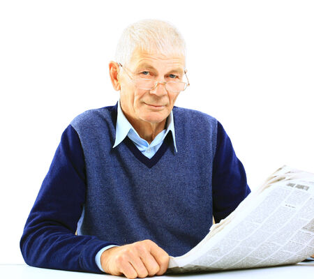 Portrait of an old man solving crosswords in the newspaper  photo