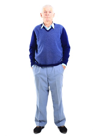 Full length of a happy senior man standing confidently on white background  photo