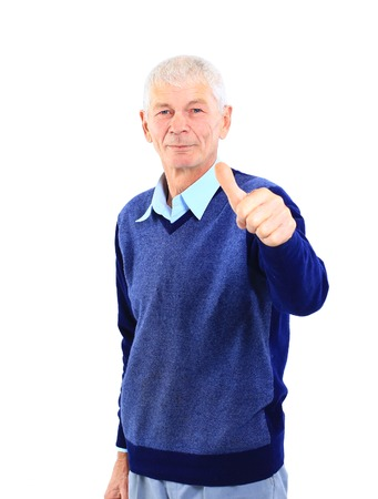 Portrait of a happy mature man showing a thumbs up on white  photo