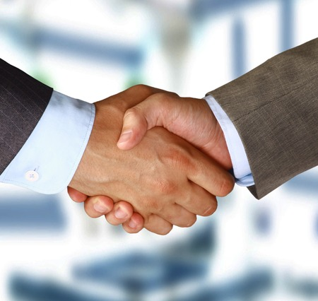 shake hand: Two businessman shaking hands  Stock Photo