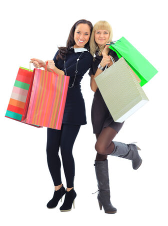 shopping buddies: two shopping women isolated on white background