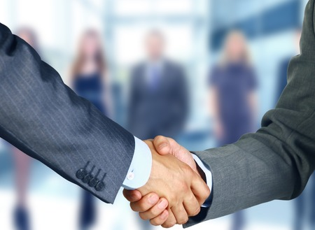 strong partnership: Business handshake and business people  Stock Photo