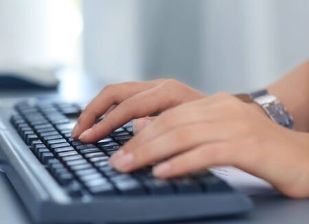 computer programmer: Close-up of typing female hands