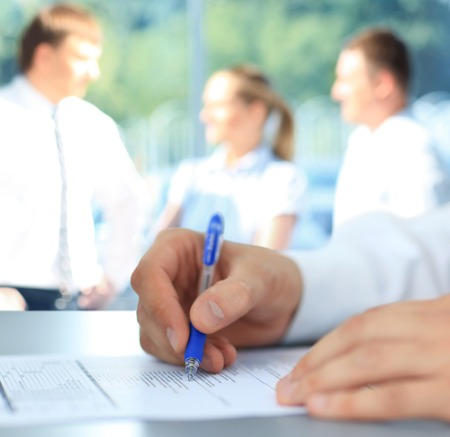 Businessman is signing a contract  photo