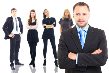 Handsome happy business man with colleagues at the back Stock Photo - 30540745