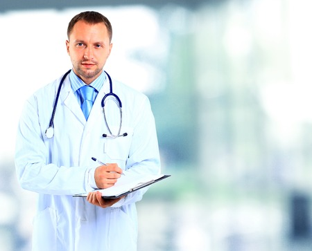 doctor office: portrait of doctor in white coat and stethoscope Stock Photo