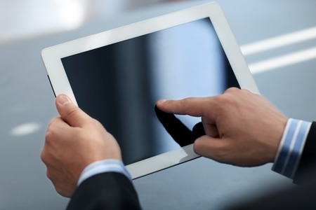 Businessman holding digital tablet Imagens