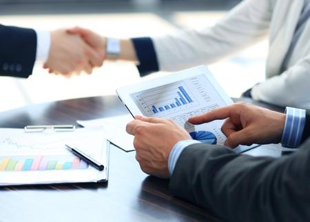 business equipment: Businessman holding digital tablet