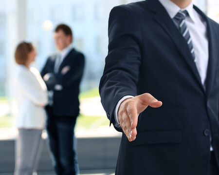 good service: A business man with an open hand ready to seal a deal