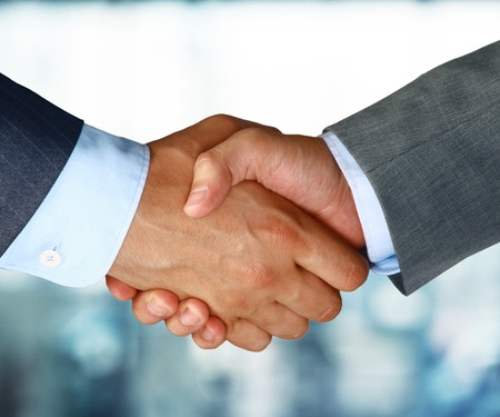 Closeup of a business hand shake between two colleagues Archivio Fotografico