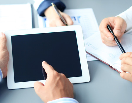 denoting: Business adviser analyzing financial figures denoting the progress in the work of the company  Stock Photo