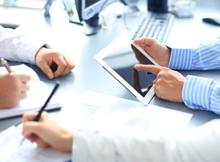 Business adviser analyzing financial figures denoting the progress in the work of the company  Stockfoto