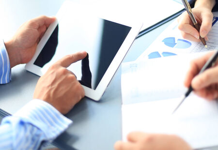 financial advisor: Business adviser analyzing financial figures denoting the progress in the work of the company  Stock Photo