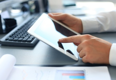 Businesswoman hands with touchpad  photo