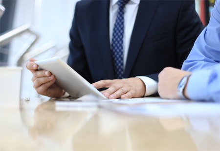 Business adviser analyzing financial figures denoting the progress in the work of the company  Stock Photo
