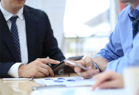 Business adviser analyzing financial figures denoting the progress in the work of the company  Imagens