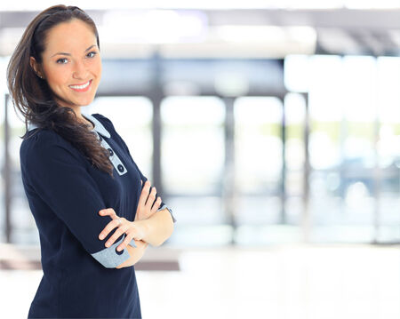 A portrait of a young business woman in an office  Stok Fotoğraf